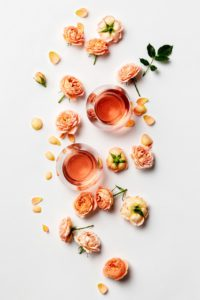 rose wine and roses on white background 8R8D6AS 1